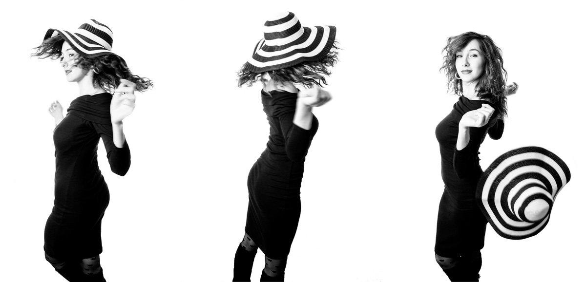 giravolta di donna con cappello a righe